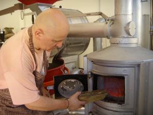 Andrea-feeding-acacia-wood-to-the-roaster
